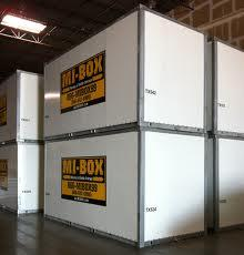 Portable storage containers stacked in a warehouse