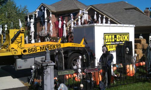 This guys needs more help than MI-BOX can give him. Look at all these Halloween decorations.